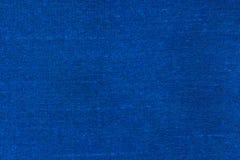 De donkerblauwe achtergrond van de stoffentextuur Royalty-vrije Stock Fotografie