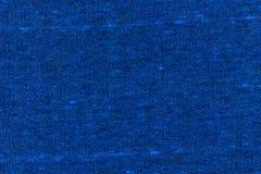 De donkerblauwe achtergrond van de stoffentextuur Stock Afbeeldingen
