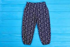 De donkerblauwe broek van het babymeisje Stock Foto's