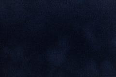 De donkerblauwe close-up van de suèdestof Fluweeltextuur Stock Foto