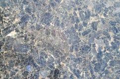 De donkerblauwe dichte omhooggaande van de het patroonoppervlakte van de graniettextuur abstracte achtergrond Zwarte steen, patro Stock Afbeelding