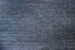 De donkerblauwe textuur van de jeansstof Stock Afbeeldingen