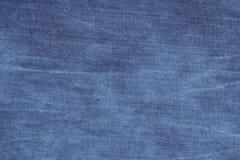 De donkerblauwe textuur van het jeansdenim Stock Fotografie
