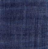 De donkerblauwe textuur van het jeansdenim Stock Foto