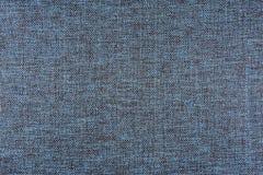 De donkerblauwe textuur van het stoffendetail Stock Foto