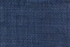 De donkerblauwe textuur van het stoffenpatroon Stock Foto's
