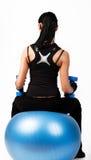 De donkerbruine gewichten van de atletenholding Stock Fotografie