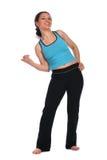 De donkerbruine kromming van het sportmeisje aan het zij grimassen trekken Stock Fotografie