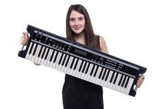 De donkerbruine synthesizer van de vrouwenholding Stock Fotografie