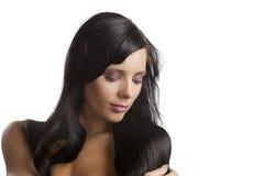De donkerbruine vrouw van het portret Stock Foto