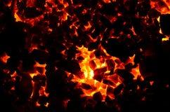 De donkere achtergrond bestaat uit vlammend steenkoolantraciet stock fotografie
