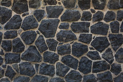 De donkere achtergrond van de steenmuur Stock Foto's