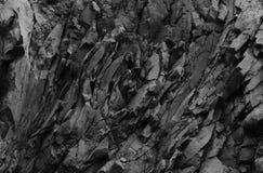 De donkere achtergrond van de steenstructuur, de achtergrond van de rotstextuur Royalty-vrije Stock Afbeeldingen
