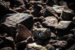 De donkere achtergrond van de steentextuur Royalty-vrije Stock Afbeeldingen