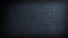 De donkere achtergrond van de stof Stock Foto's