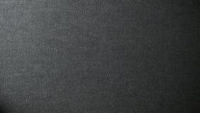 De donkere achtergrond van de stof Stock Afbeelding