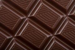 De donkere achtergrond van het chocoladeblok Stock Afbeeldingen