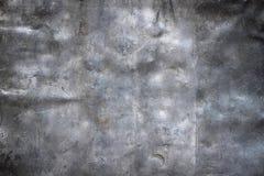 De donkere achtergrond van het grungemetaal, de zwarte close-up van de ijzertextuur Stock Foto's