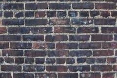 De donkere bakstenen, maken doorstane muurachtergrond zwart Royalty-vrije Stock Foto's
