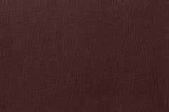 De donkere bruine achtergrond van de leertextuur met patroon, close-up Stock Fotografie