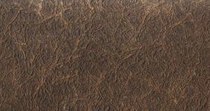 De donkere bruine achtergrond van de leertextuur Sluit omhoog van een oude leertextuur van de leertextuur bruin patroon als achte Stock Afbeeldingen