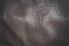 De donkere bruine achtergrond van de leertextuur Royalty-vrije Stock Fotografie