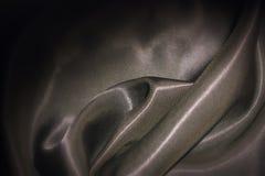 De donkere Bruine Achtergrond van de Satijnzijde Stock Afbeelding