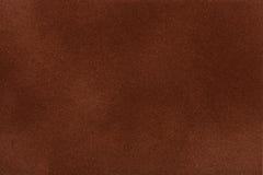 De donkere bruine close-up van de suèdestof Fluweeltextuur Stock Foto