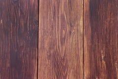 De donkere bruine houten textuur van de plankmuur Landhuisachtergrond Stock Afbeelding