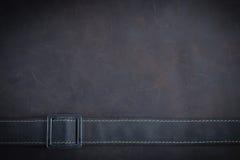 De donkere bruine Nubuck-leerachtergrond en de textuur Royalty-vrije Stock Foto's