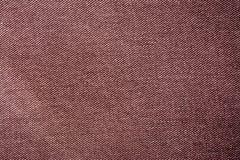 De donkere bruine wijnachtergrond van de de jeans materiële textuur van Bourgondië Stock Foto