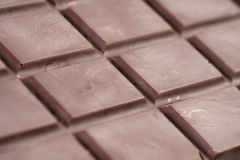 De donkere foto van de chocoladereepclose-up Stock Afbeelding