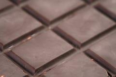 De donkere foto van de chocoladereepclose-up Stock Foto