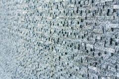 De donkere grijze bakstenen muur van de steentegel Stock Afbeeldingen