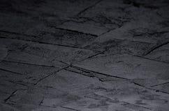 De donkere grijze muur van de grunge ruwe concrete textuur Royalty-vrije Stock Foto