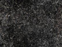 De donkere grijze natuurlijke ruwe naadloze achtergrond van het de textuurpatroon van de granietsteen De ruwe oppervlakte van de  Stock Afbeelding