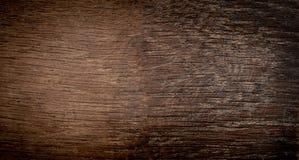 De donkere houten achtergrond van de schorstextuur met oud natuurlijk patroon donker Stock Foto