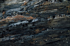 De donkere kleur van de rotssteen voor textuurachtergrond Stock Afbeeldingen