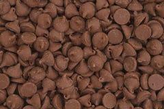 De donkere melkchocola breekt achtergrond af Stock Fotografie