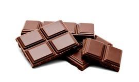 De donkere melkchocola verspert geïsoleerde stapel Stock Afbeelding