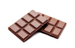 De donkere melkchocola verspert geïsoleerde stapel Royalty-vrije Stock Fotografie