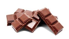 De donkere melkchocola verspert geïsoleerde stapel Royalty-vrije Stock Foto's