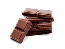 De donkere melkchocola verspert geïsoleerde stapel Royalty-vrije Stock Foto