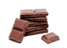 De donkere melkchocola verspert stapel op een wit Royalty-vrije Stock Foto