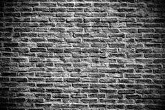 De donkere nevelige bakstenen muur voor achtergrond, modren binnenlandse ruwe textuur Stock Fotografie