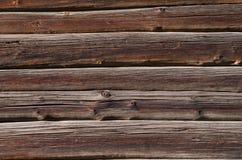 de donkere oude houten raad met lichte vlekken, wordt horizontaal geschikt Stock Foto