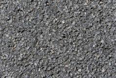 De donkere ruwe textuur van de asfaltweg Stock Foto