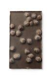 De donkere tablet van de hazelnotenchocolade Stock Afbeelding
