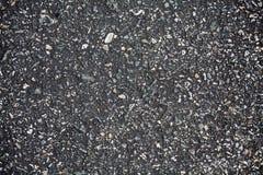 De donkere textuur van de asfaltweg Stock Afbeelding
