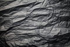 De donkere textuur van verfrommeld document, zwarte achtergrond Royalty-vrije Stock Afbeeldingen